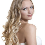 a young blond bride with long curly hair