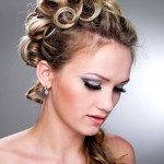 Blonde curls piled on top.