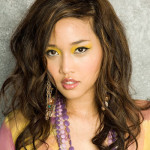 Pretty asian woman in stylish dress