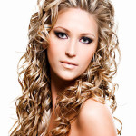 Beautiful woman with  blonde long ringlets hair