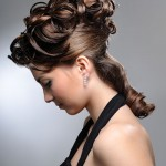Curly updo and ponytail combination.