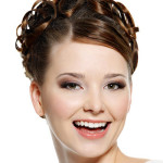 Happy laughing young woman portrait with beautiful curled hairstyle