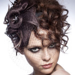 Fashion portrait of sexy woman with an original hairdress and a make-up