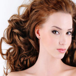 Beauty Face of the attractive young woman with curly hairs