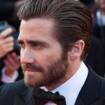Jake Gyllenhaal with Brushed Back Hair and a Full Beard.